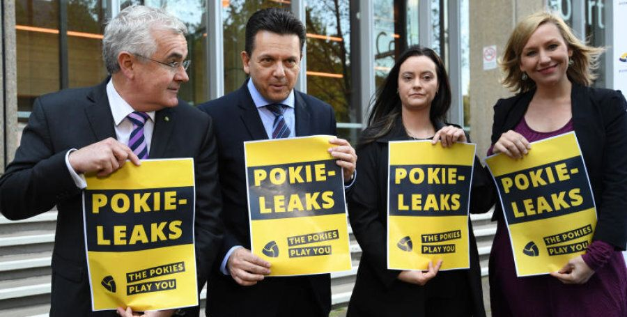 Wilkie, Xenophon, former pokie machine victim, Shonica Guy and Greens Senator Larissa Waters set up