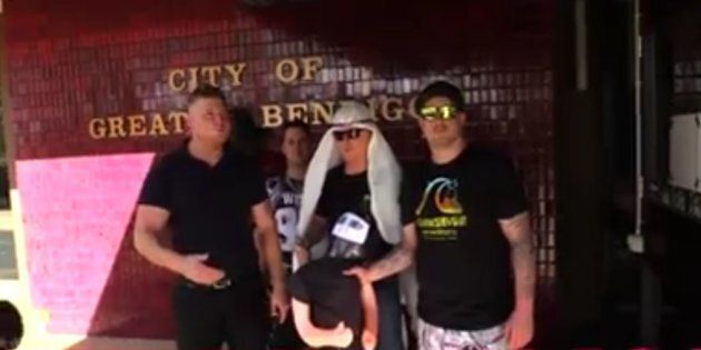 A still from the video, showing Cottrell (left) and other UPF members holding the