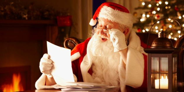 Portrait of Father Christmas Reading letters from children in his grotto
