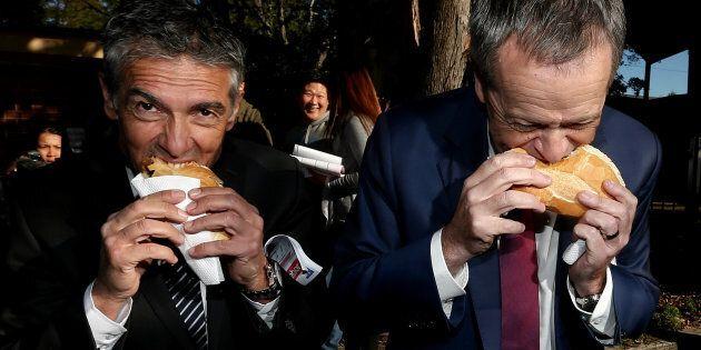 Opposition Leader Bill Shorten and ALP candidate Angelo Tsirekas get their democracy sausage