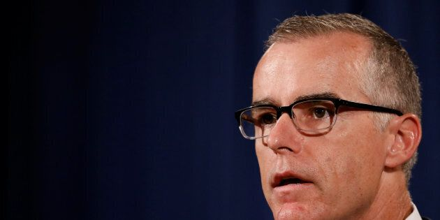 FBI Acting Director Andrew McCabe speaks during a news conference announcing the takedown of the dark...