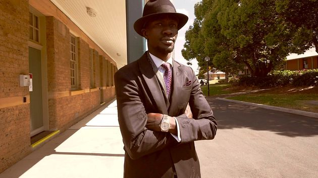 Deng Adut has eight hats on rotation and three different tailors across