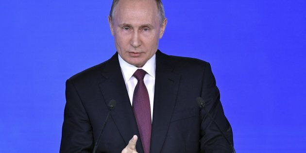 Russian President Vladimir Putin addresses the Federal Assembly, including the State Duma parliamentarians,...