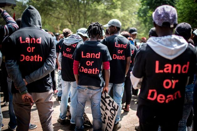 Members of political party Black First Land First (BLF) wear shirt with the lettering 'Land or Death' as they prepare to march.
