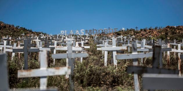 Crosses are planted on a hillside at the White Cross Monument, each one marking a white farmer who has...