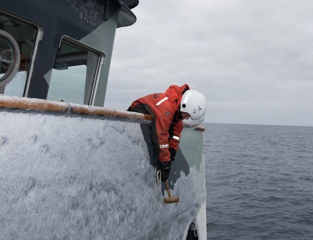 Elissa Sursara removing ice from the bridge wing of the MV Sam