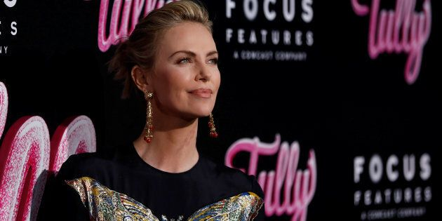 Charlize Theron poses at the premiere