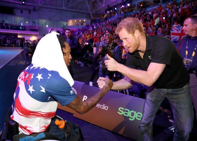 Prince Harry congratulates the US team at the Wheelchair Basketball Finals during the 2017 Invictus Games.
