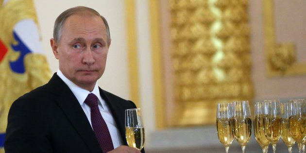 MOSCOW, RUSSIA - NOVEMBER 9:  (RUSSIA OUT) Russian President Vladimir Putin takes a glass of champagne during the reception for new foreign ambassadors at Grand Kremlin Palace on November 9, 2016 in Moscow, Russia. Putin has received credentials from 19 new foreign ambassadors and also extended congratulates to Donald Trump the winner of U.S. Presidential election today.  (Photo by Mikhail Svetlov/Getty Images)