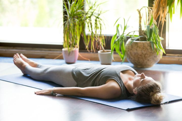 Light candles and use an eye mask to make Savasana super relaxing.