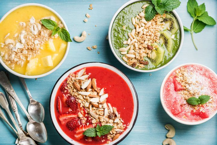 Top your smoothie bowls with nuts, granola and more fresh fruit.
