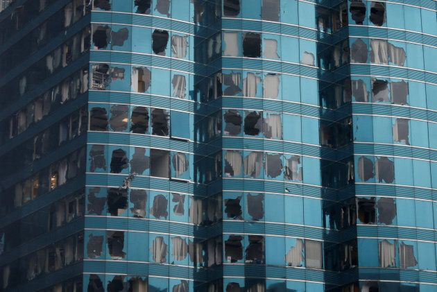 Damaged windows of the One Harbourfront office tower are seen following Typhoon Mangkhut, in Hong