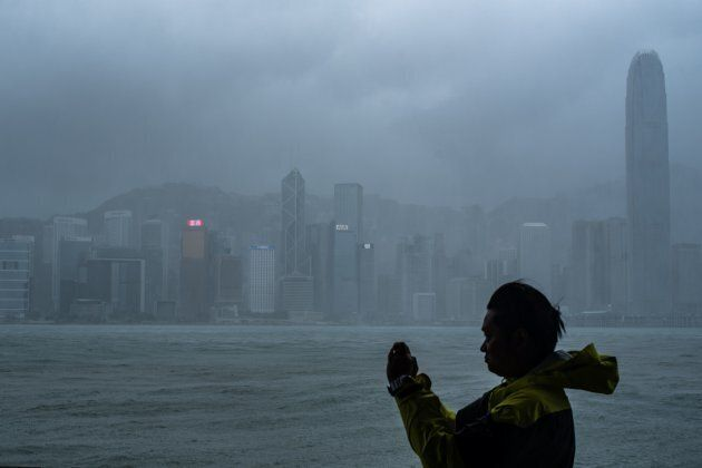 A man takes photos during the approach of super Typhoon Mangkhut to Hong