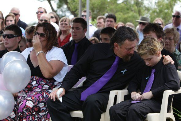 John Rice comforts his son Kyle at the funeral of his brother Jordan Lucas Rice and mother Donna Maree
