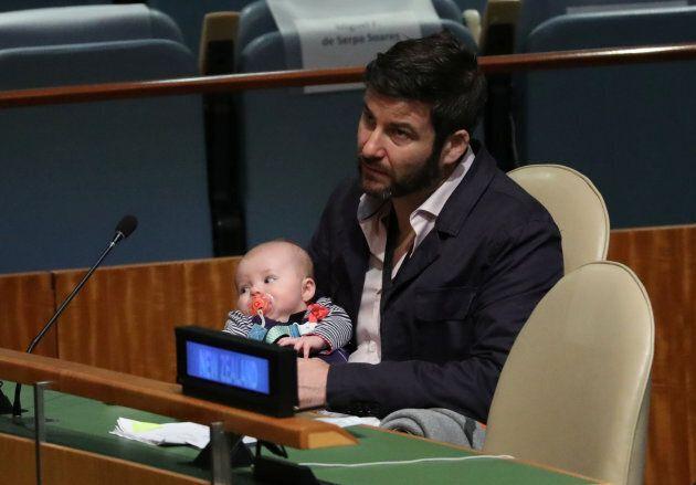Clarke Gayford, partner to New Zealand Prime Minister Jacinda Ardern holds baby Neve as Ardern speaks...