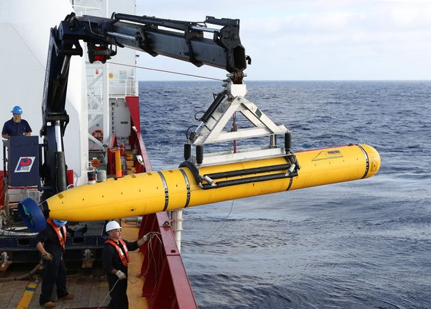 An Autonomous Underwater Vehicle is craned over the side of Australian Defence Vessel Ocean Shield in...