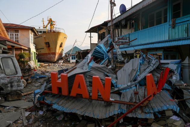 A ship is seen stranded on the shore after the earthquake and tsunami hit an area in Wani, Donggala,...