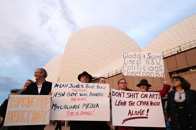 A large crowd gather to protest against racing advertising on the Opera House sails.