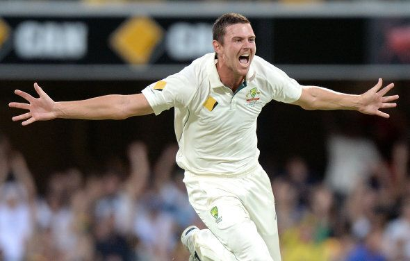 Hazlewood prepares to hug 10 men who are very happy he's in the