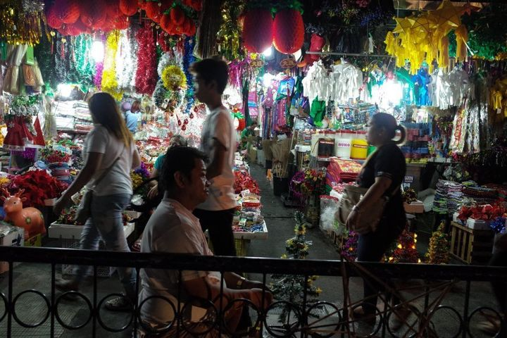 A man arranges a small Christmas tree at a dry market in Quezon City, east of Manila.