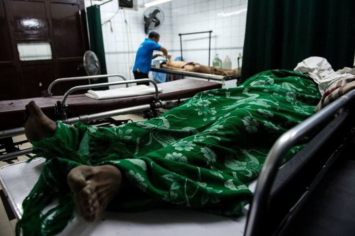 Workers process bodies at a morgue in Manila in early December.