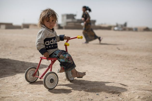 *Jasm, 2, plays on a trike in a camp for displaced people in the village of Tinah some 70km south of...