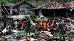 Rescuers Dig Through Rubble For Survivors After Indonesian Tsunami Kills