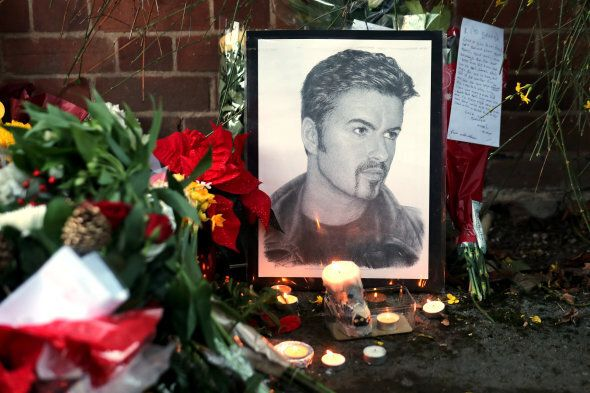 Tributes are seen outside the house of singer George Michael, where he died on Christmas Day, in Goring,...