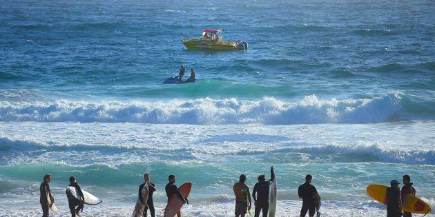Surfers are called out of the water as NSW Search and Rescue alongside Surf lifesavers search for a 14...