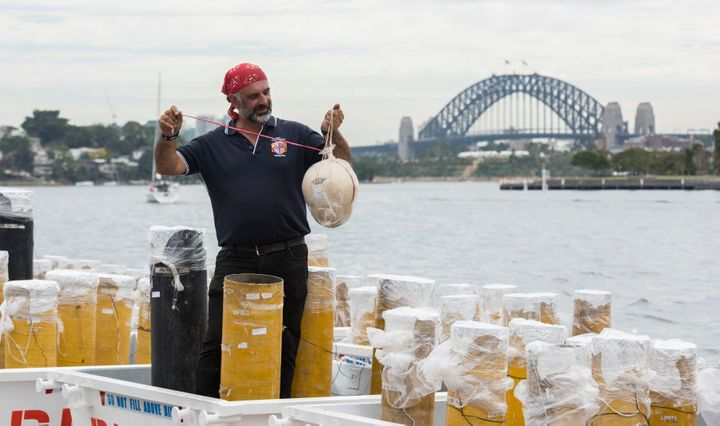 Fortunato Foti, Sydney's NYE fireworks director from Foti Fireworks holds one of the shells on December 29, 2016 in Sydney, Australia. Sydney's New Year's Eve fireworks displays include seven tonnes of fireworks, 12,000 shells, 25,000 shooting comets and 100,000 individual pyrotechnic effects. Additionally, this years display will fire from 7 barges on the harbour, the Sydney Opera House and 175 points on the Sydney Harbour Bridge.
