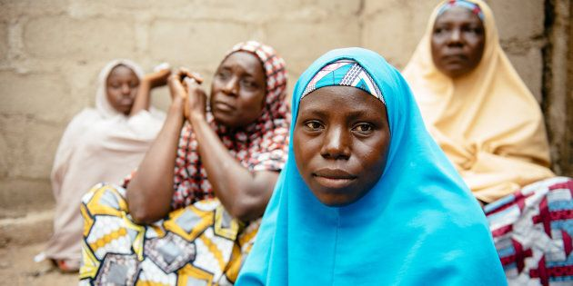 Aisha, 30, (blue hijab) in Biu, Borno State Nigeria. She and her four children were displaced3years ago after Boko Haram raided her village and killed her husband and two brothers.