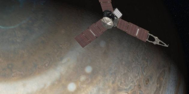 An artist's rendering depicts NASA's Juno spacecraft above Jupiter's north pole in this undated handout image.  NASA/JPL-Caltech/Handout via Reuters/File photo  ATTENTION EDITORS - THIS IMAGE WAS PROVIDED BY A THIRD PARTY. EDITORIAL USE ONLY