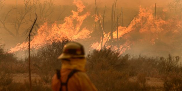 An uncontrolled bushfire is threatening homes in regional Victoria.