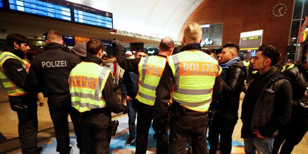 Police officers of Germany's federal police Bundespolizei check young men at the main railways station following New Year celebrations in Cologne, Germany, January 1, 2017.