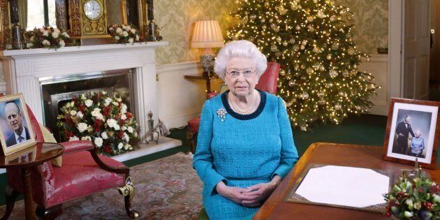 Britain's Queen Elizabeth II sits at a desk in the Regency Room in Buckingham Palace in London, after recording her Christmas Day broadcast to the Commonwealth which is to be broadcast on December 25, 2016.  / AFP / POOL / Yui Mok        (Photo credit should read YUI MOK/AFP/Getty Images)