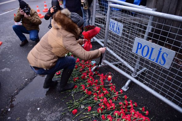 People lay flowers in front of the Reina night club following the massacre on New Year's
