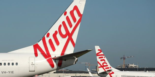 Virgin Australia check-in queues have left passengers waiting at Sydney Airport on