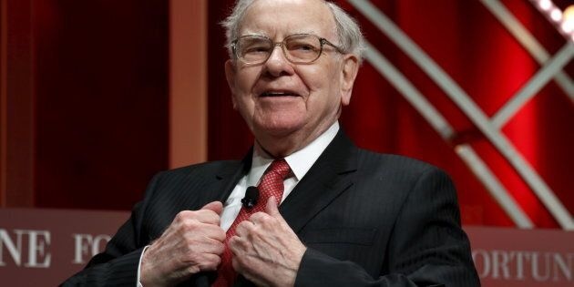 Warren Buffett, chairman and CEO of Berkshire Hathaway, takes his seat to speak at the Fortune's Most...