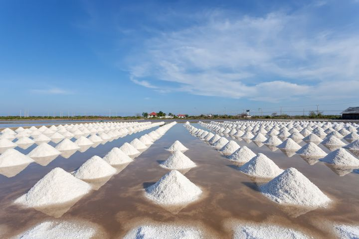 Salt in a sea salt farm ready for harvest in Thailand.
