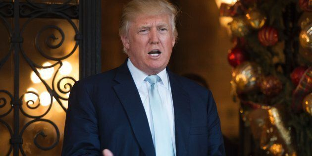 US President-elect Donald Trump answers questions from the media after a day of meetings on December 28, 2016 at Mar-a-Lago in Palm Beach, Florida. / AFP / DON EMMERT        (Photo credit should read DON EMMERT/AFP/Getty Images)