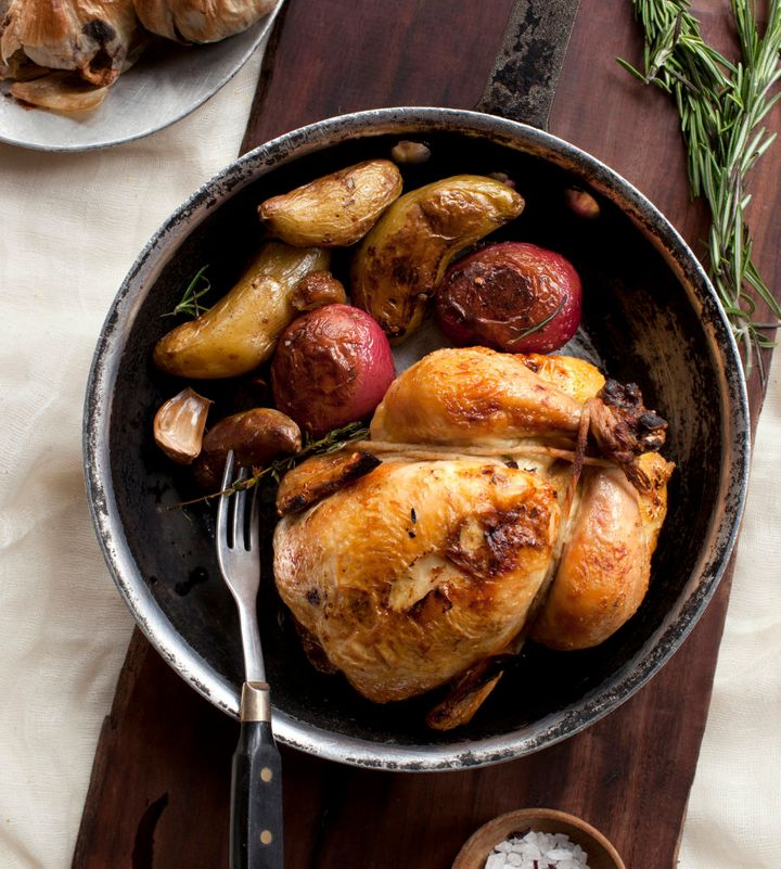 Use herbs like rosemary and thyme to flavour your chicken roast.