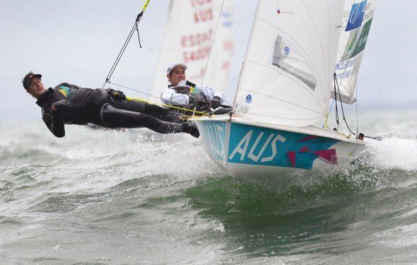 Mathew Belcher and Will Ryan of Australia sail through the waves in the 470 Men's class at the ISAF Sailing...