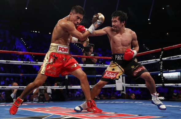 Manny Pacquiao (R) defeated Jessie Vargas in Las Vegas in November, during their WBO welterweight championship