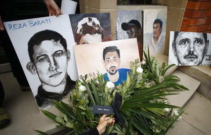 A picture of Reza Barati, who was killed in Manus Island, and other people who died in Australian immigration detention centres.