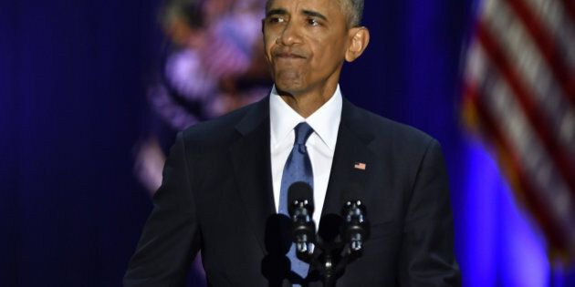 U.S. President Barack Obama reacts while speaking about U.S. First Lady Michelle Obama, not pictured,...
