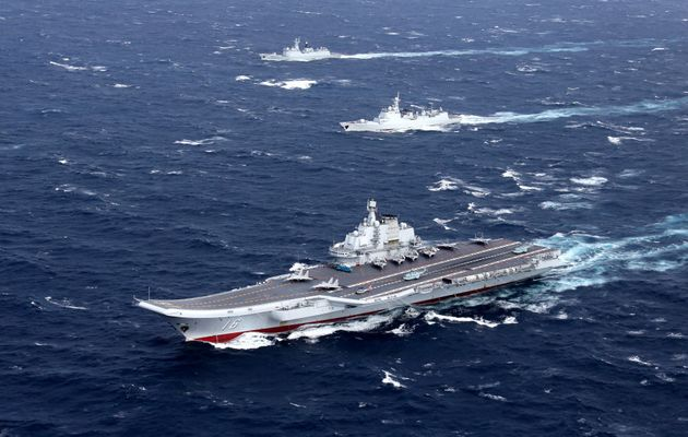 China's Liaoning aircraft carrier with accompanying fleet conducts a drill in an area of South China...