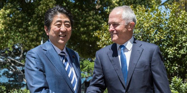 Japanese Prime Minister Shinzo Abe is greeted by the Australian Prime Minister Malcom Turnbull on arrival...