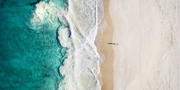 Just one person walking along Perth's Floreat Beach becomes a work of art with drone