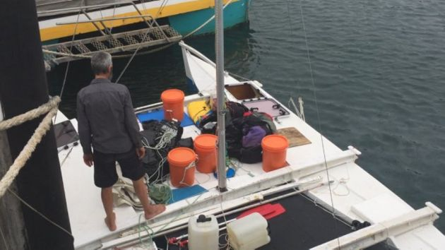 Alan Langdon on the deck of his catamaran in Ulladulla Harbour on