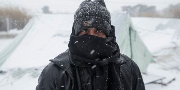 Hundreds of refugees face the extreme low temperatures in northern Greece in camps in or around Thessaloniki city on 11 January 2017. In Softex camp the temperature was -8°C with real feeling sense below -13°C and there was about 20cm of snowfall during a half day heaby snowstorm. The tents were snow covered. There is no running water as the pipes froze and many tents don't have electricity and heating. Also many refugees without document have been forced to leave the camp.  (Photo by Nicolas Economou/NurPhoto via Getty Images)